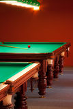 Interior of a club having billiard tables. Illuminated with lights Royalty Free Stock Photo
