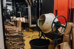 Interior of coffee production workshop with industrial equipment. And packaging stock photos