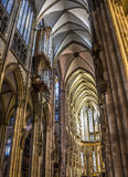 Interior of Cologne cathedral. The Interior of Cologne Cathedral with the organ and gothic columns and vaults Royalty Free Stock Photos
