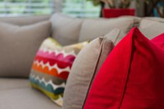 Interior color. Hgtv pillows red Stock Photography