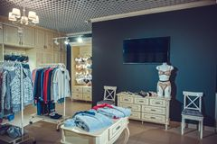 Interior of a colorful modern underwear shop. Female mannequin in panties and bras and stands in a shopping center. Cozy light. Cu Royalty Free Stock Image