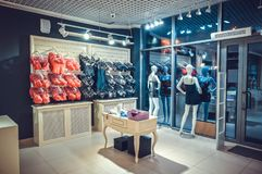 Interior of a colorful modern underwear shop. Female mannequin in panties and bras and stands in a shopping center. Cozy light. Cu Royalty Free Stock Photo