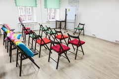 Interior of colorful room for business meeting with arranged chairs and flipchart. Office space Stock Image
