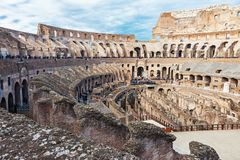Interior of Colosseum in Rome. Interior of Colosseum, iconic symbol of Imperial Rome on cloudy day in Rome, Italy royalty free stock image