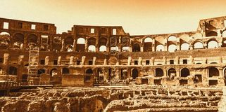 Interior of the Colosseum, Rome. Retro style. Royalty Free Stock Images