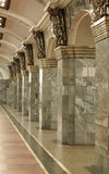 Interior with columns. Fragment of the interior with columns lined with gray granite and metal decor Royalty Free Stock Photo