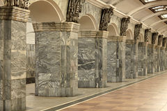 Interior with columns. Fragment of the interior with columns lined with gray granite and metal decor Stock Photography