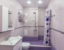 Interior of a combined sanitary unit in apartment. Interior of a combined sanitary unit in the apartment Royalty Free Stock Images