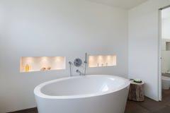 Interior, comfortable bathroom. Comfortable bathroom in modern design, wooden floor Royalty Free Stock Photo