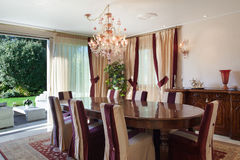 Interior, comfortable dining room. Comfortable dining room of an house, classic design furniture Royalty Free Stock Photos