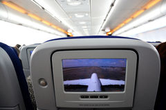 Interior of commercial aircraft- close-up of LCD rear seat showing live images from outside the plane Royalty Free Stock Photos
