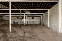 Interior commercial construction remodel. Interior commercial space undergoing construction remodeling process - old industrial service space ready to be royalty free stock photo