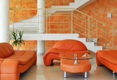 Interior con muebles y escaleras Imágenes de archivo libres de regalías