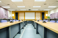 Interior conference room with white projector board. Stock Photos