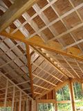 Interior - construction - 3. Part of timber construction showing ridge pole, rafters, beams, strapping, stud and openings for windows Royalty Free Stock Photo