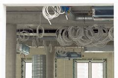 Interior construction site. Cabling and wiring of new office place.  royalty free stock images