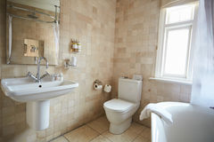 Interior Of Contemporary Bathroom With Tiled Walls Stock Photo