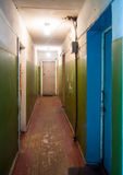 Interior corridor dilapidated door of the apartment in an old dormitory Royalty Free Stock Images