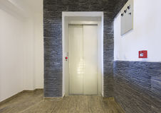 Interior of a corridor with elevator door Stock Images