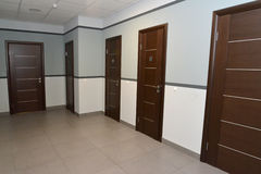 Interior of a corridor of office building with doors Royalty Free Stock Photos