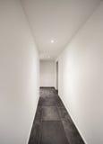 Interior, corridor with tiled floor black Stock Photos