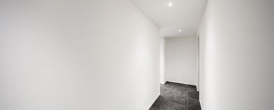 Interior, corridor with tiled floor black Stock Images