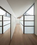 Interior, corridor with wall closets. Interior of a modern house, long corridor with wall closets stock photography