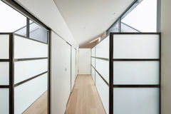 Interior, corridor with wall closets. Interior of a modern house, long corridor with wall closets royalty free stock image