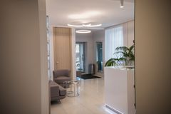 Interior of cosmetology clinic. Beige colors. Reception