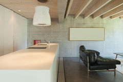 Interior, counter top of kitchen. Interior of a modern chalet in cement, counter top of kitchen stock images
