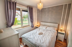 Interior of a country home bedroom. Royalty Free Stock Images