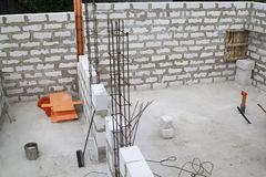 interior of a country house under construction. Site on which the walls are built of gas concrete blocks stock images