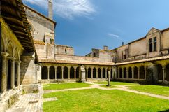Collegiate Church and Cloisters, Saint-Emilion, France. Interior courtyard of the Collegiate Church with double arched columns Stock Image
