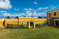 Interior courtyard of Fort Christiansted in St. Croix Virgin Isl. Ands with green fence and grass courtyard Stock Image