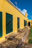 Interior courtyard of Fort Christiansted in St. Croix Virgin Isl. Ands.  Green stable doors against yellow walls Stock Image