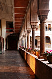 Interior courtyard of the Koricancha Cathedral. With a pot of flower and a pillar royalty free stock photo