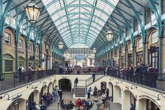 Interior of Covent Garden Market in Westminster City, Greater London. London, UK - April 2018: Interior of Covent Garden Market, a place for fashionable retail stock photography