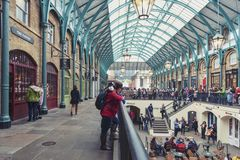 Interior of Covent Garden Market in Westminster City, Greater London. London, UK - April 2018: Interior of Covent Garden Market, a place for fashionable retail stock image