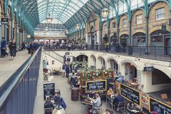 Interior of Covent Garden Market in Westminster City, Greater London. London, UK - April 2018: Interior of Covent Garden Market, a place for fashionable retail stock images