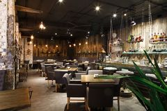 Interior of cozy restaurant, loft style. Interior of cozy restaurant. Contemporary design in loft style, modern dining place and bar counter, copy space