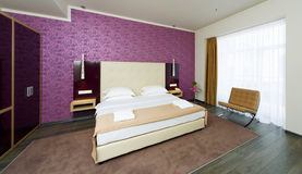 Interior The cozy rooms with a large bed and a large window Royalty Free Stock Images