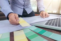 Interior Creative creativity graphic designer working with graph. Ics laptop, blueprint and colour chart at workplace on wooden desk , colour ideas style concept stock photo