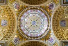 Interior of the cupola. Decorated ceiling with mural and gold. Royalty Free Stock Image