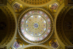 Interior of the cupola. Decorated ceiling with mural and gold. royalty free stock photography