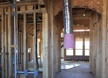 Interior da casa nova sob a construção Imagens de Stock