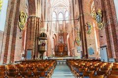 Interior da catedral de St Peter em Riga, Letónia Os oldes fotos de stock royalty free