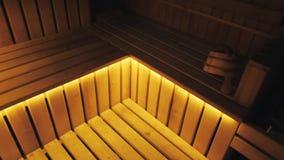 Interior da sauna finlandesa e dos acessórios da sauna filme