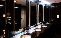 Interior of dark restroom stock photography