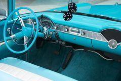 Interior Dashboard of Classic 1956 Convertible. Interior shot of a blue colored 1956 convertible with fuzzy dice Stock Photos