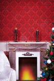 Interior de Christimas en sitio rojo del vintage Foto de archivo libre de regalías